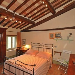 Bramasole: The large double bedroom with chestnut beams and authentic features