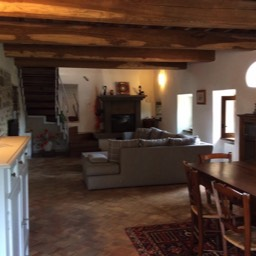 Apartment Alice: The living / dining room, plenty of space and Tuscan charm for relaxing holidays in Tuscany