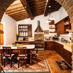 Palazzolo Farmhouse: Arched cotto architrave and the handmade chestnut built kitchen with marble top, perfect for breakfasts in Tuscany