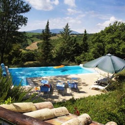 Villa Calcina: Looking down at the heated pool and view of the Tuscan countryside