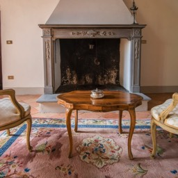 Villa Paradiso: An original stone fireplace in the historic holiday villa