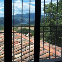 Villa Sergia: Gazing through one of the upstairs windows at the views