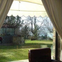 Villa Sergia: Peering out of one of the large windows to the large grounds